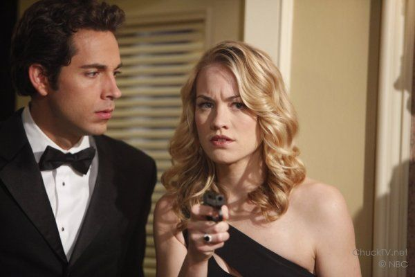 Zachary Levi in a tux and Yvonne Strahovski holding a gun on Chuck