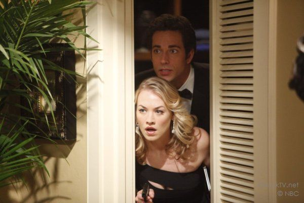 Yvonne Strahovski and Zachary levi hiding in a closet on Chuck.