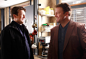 Nathan Fillion and Adam Baldwin on the set of Castle