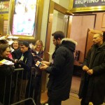 Signing autographs after the show